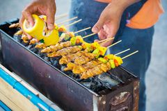 Chef cooking at barbecue dinner buffet. Barbecue Grill Street Food in Thailand stock photos