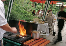 Chef cooking a BBQ at the pub. Outdoor BBQ by a chef at a bar / pub Stock Photo