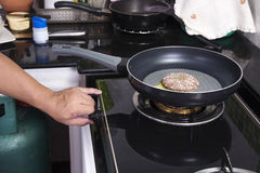 Chef cooking beef Burger in the pan Stock Image