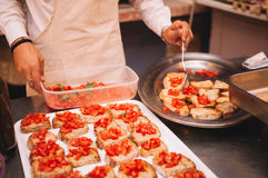 Chef Cooking Bruschette Stock Photo