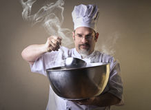 Chef cooking on a casserole Royalty Free Stock Photography