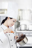 Chef cooking chocolate in kitchen Stock Photos
