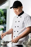 Chef cooking in a commercial kitchen Royalty Free Stock Photo