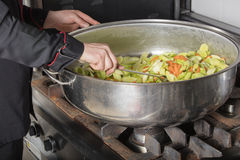 Chef cooking at commercial kitchen Stock Images