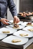 Chef cooking for dinner. Chef in hotel or restaurant kitchen cooking for dinner Royalty Free Stock Image
