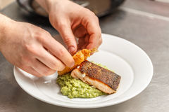 Chef is cooking for dinner. In restaurant kitchen Royalty Free Stock Image
