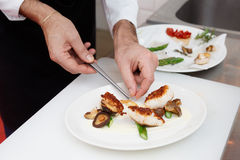 Chef is cooking a fish dish Royalty Free Stock Photography
