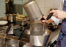 Chef is cooking food in boiler Stock Image