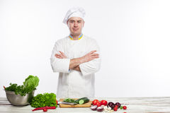 Chef cooking fresh vegetable salad in his kitchen Stock Image