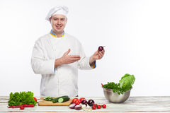 Chef cooking fresh vegetable salad in his kitchen Stock Images