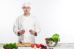 Chef cooking fresh vegetable salad in his kitchen Royalty Free Stock Image