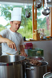 Chef cooking goulash Stock Photo