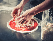 Chef cooking gourmet pizza Royalty Free Stock Image