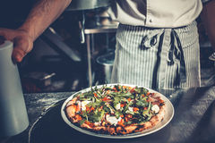Chef cooking gourmet pizza Royalty Free Stock Photos