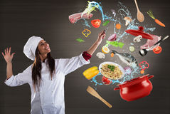 Chef cooking with harmony. Woman chef cooking with harmony food in a big pot stock images