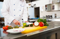 Chef cooking in his kitchen Royalty Free Stock Photography