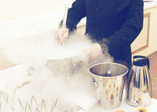 Chef is cooking ice cream with liquid nitrogen Royalty Free Stock Photos