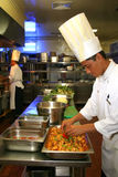 Chef cooking at kitchen Royalty Free Stock Photography