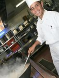 Chef cooking at kitchen stock photography