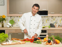 Chef cooking in kitchen Stock Photo