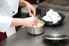 Chef cooking in kitchen Stock Images