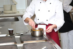 Chef cooking in kitchen Royalty Free Stock Photography