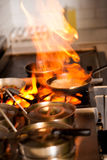 Chef cooking in kitchen stove Stock Images