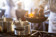 Chef cooking in kitchen stove Royalty Free Stock Image