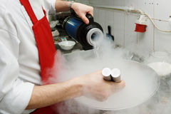 Chef is cooking with liquid nitrogen Royalty Free Stock Photography