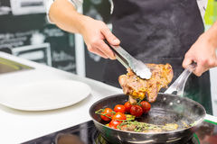 Chef cooking meat Royalty Free Stock Photography