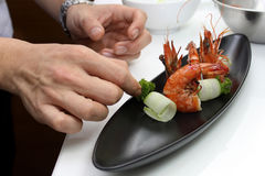 Chef cooking  menu Pan Fried Tiger Prawn with Curly Cucumber Royalty Free Stock Photos