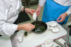 Chef cooking mussels Stock Photography