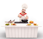 Chef cooking nonveg on the table Stock Photography