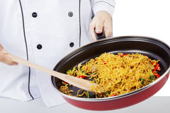 Chef cooking noodle with a pan Stock Image