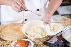 Chef cooking Noodle with vegetable oil Royalty Free Stock Image