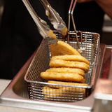 Chef is cooking nuggets in deep fryer Stock Images