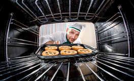 Chef cooking in the oven. Royalty Free Stock Photos