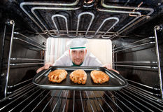 Chef cooking in the oven. Stock Image