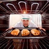 Chef cooking in the oven. royalty free stock photo