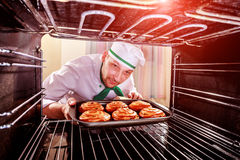 Chef cooking in the oven. royalty free stock photography
