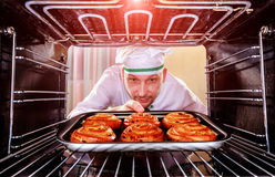 Chef cooking in the oven. stock photo