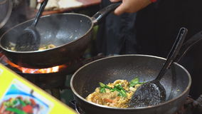 Chef cooking Pad Thai stir-fried rice noodles with shrimp stock footage