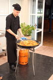 Chef cooking paella Royalty Free Stock Photos