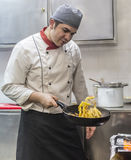 Chef Cooking Pasta. Image of a chef cooking pasta in a restaurant kitchen Royalty Free Stock Photos