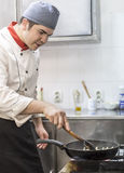 Chef Cooking Pasta. Image of a chef cooking pasta in a restaurant kitchen Stock Images