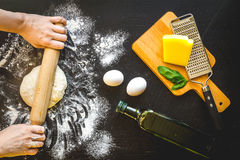 Chef cooking pasta top view on dark background Stock Photo