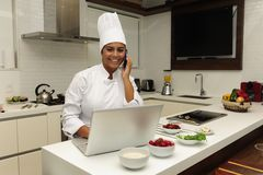 Chef cooking on phone royalty free stock photo