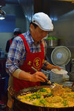Chef cooking at the popular Yuan Huan Bian Restaurant famous for its oyster omelette Stock Image