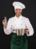 Chef cooking with pot Royalty Free Stock Photography
