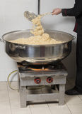 Chef cooking rice at a commercial kitchen Stock Photo